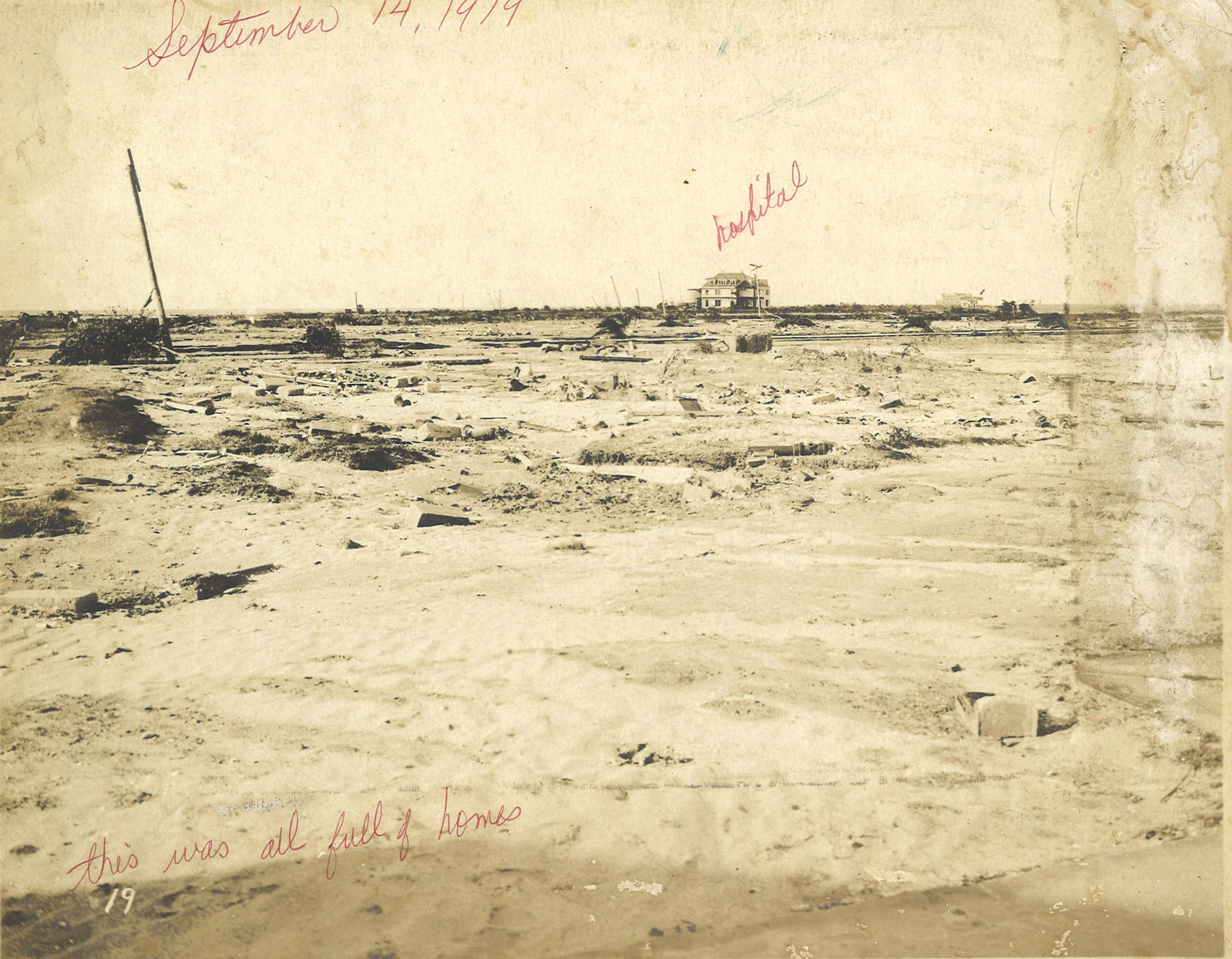 Spohn Sanitarium on North Beach (labeled hospital), one of only three buildings that survived the 1919 hurricane in Corpus Christi. In the far distance is Judge Henry McDonald's home and U.S. General Hospital No. 15. The sanitarium is where the Texas State Aquarium stands now. From the collection of Inez Hendrix Stairs.