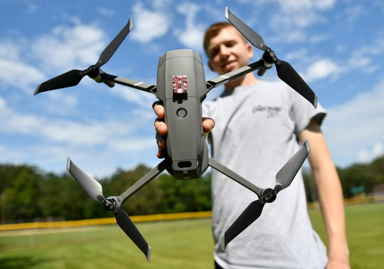 Jon Moraglia, owner of The Drone Life, shows off some of his drone equipment on Monday, September 9, 2019.