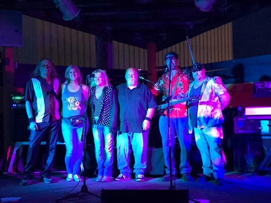 Jamie Southern Elliott with Far From Angels (Rick Cruse, Jamie Southern Elliott, Kathy Cruse, Tim Odle, Tony Federici, and Bret Jones) at the Rock Out Childhood Cancer event.