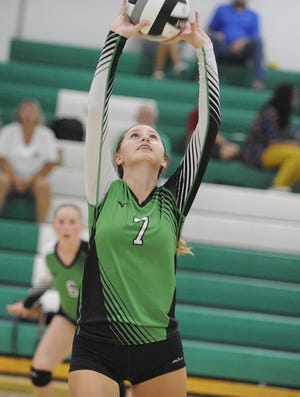 Huntington volleyball's Alyssa Steele sets the ball during a match against Westfall at Huntington High School in Chillicothe, Ohio on Tuesday Sept. 10, 2019.