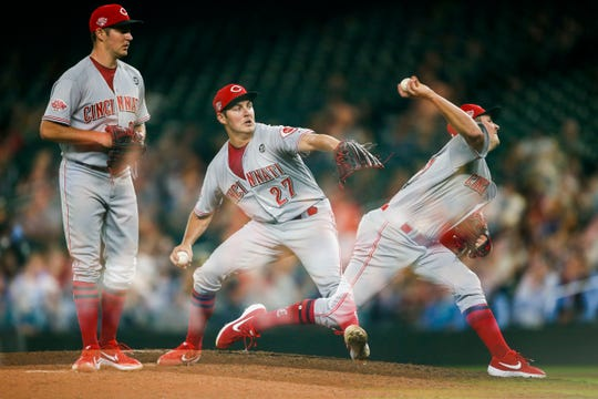 Sep 10, 2019; Seattle, WA, USA; (editors note: multiple exposure used to create this image) Cincinnati Reds starting pitcher Trevor Bauer (27) throws against the Seattle Mariners during the sixth inning in this multiple exposure frame at T-Mobile Park. Mandatory Credit: Joe Nicholson-USA TODAY Sports