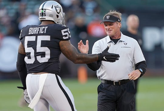 Head coach Jon Gruden of the Oakland Raiders greets linebacker Vontaze Burfict prior to their game against the Denver Broncos at RingCentral Coliseum on September 9, 2019 in Oakland, California.