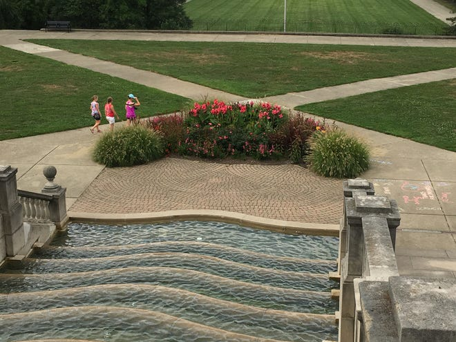 The cool water tumbling down this  fountain at Ault Park in Mount Lookout will looking increasingly inviting as hot weather continues to blanket the Tristate.