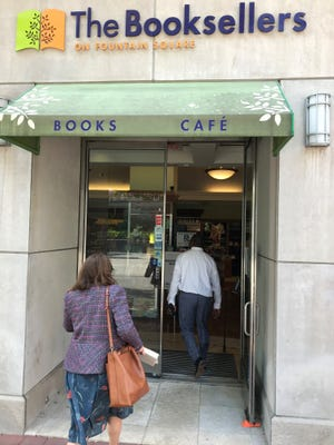 Customers visit The Booksellers on Fountain Square after it reopened on Wednesday.