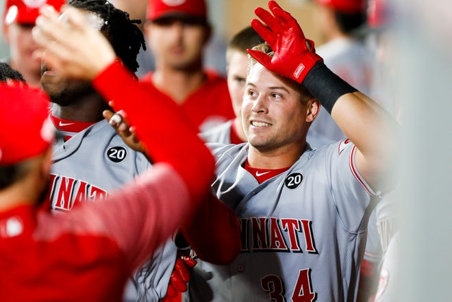 Cincinnati Reds pinch-hitter Brian O'Grady (34) celebrates in the dugout after hitting a two-run home run against the Seattle Mariners during the seventh inning at T-Mobile Park on Sept. 10.