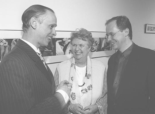 Alice Weston at the 1997 opening of the  Photo-Op exhibit at the Contemporary Arts Center featuring photographs by Tim Burton, Dennis Hopper, David Lynch and John Waters. At the event with Weston were Waters (left) and Charles Desmarais, the then-CAC director.