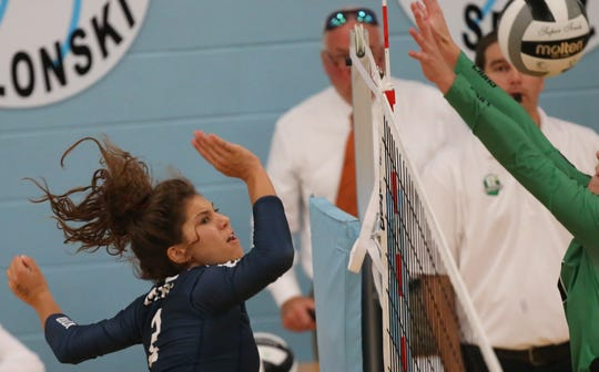 MND player Carly Hendrickson (2) tries to get the ball over the net during their volleyball game against  Ursuline , Tuesday, Sept. 10,2019.