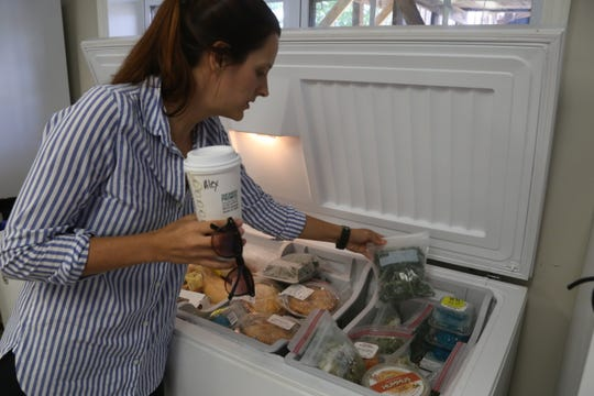 Alexandra Wills with Austin Peay State University's student food pantry shows some of the food stored in their deep freezer on Sept. 11, 2019.