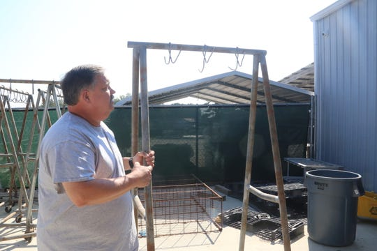 Keith Clow with Hunters Harvest shows the racks they use to hang deer in a cooler before processing.