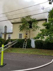 Smoke billows from a fire at a Ray Street home in Franklin Township.