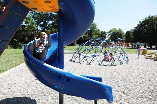 Zyler Leigh, a fourth grader, slides down a slide at Warsaw Elementary School. River View Local Schools was able to bring some of the playground equipment at Union Elementary School to Warsaw.