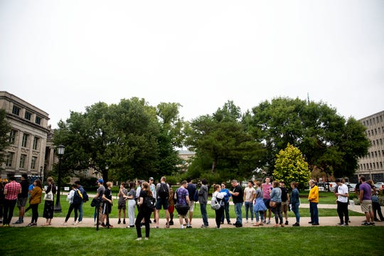 A crowd of people, partly made up of college students, line up at the Pentacrest on the University of Iowa campus to attend a rally with U.S. Sen. Bernie Sanders, I-Vt., on Sunday, Sept. 8, 2019, in Iowa City. Sanders' visit was the first campaign rally on the U of I campus during the 2019-2020 school year.