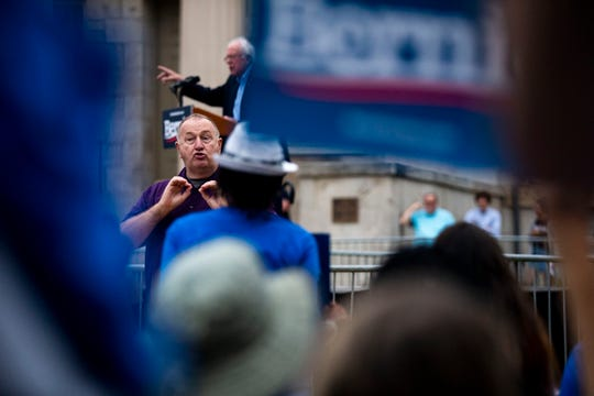 Bill Ainsley, a sign language interpreter, translates a speech by U.S. Sen. Bernie Sanders of Vermont during a rally on Sept. 8 at the University of Iowa campus in Iowa City.