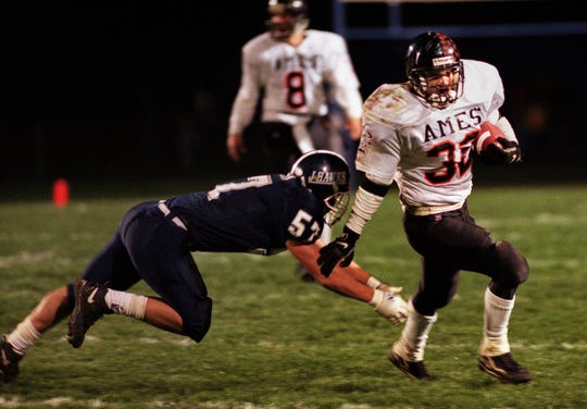 Nov. 4, 1998: Ames running back Aaron Greving breaks free during the first half of a Class 4A game against Urbandale.