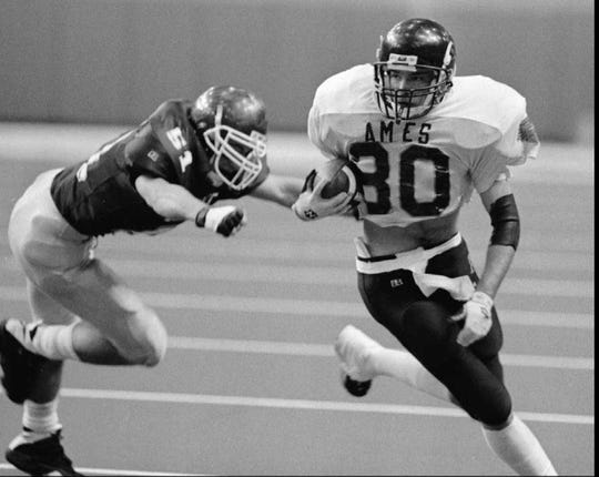 Nov. 13, 1995: Dustin Avey of Ames tries to elude Dowling Catholic's Jason Poland during a Class 4A semifinal game at the UNI-Dome in Cedar Falls.