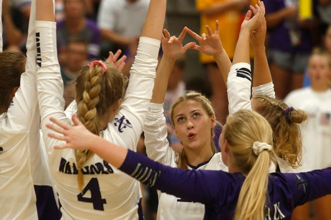 Norwalk junior Grace Sutcliffe and other Norwalk players celebrate a point. Norwalk beat Pella Christian in three games in a Little Hawkeye Conference match in Norwalk on Sept. 10.