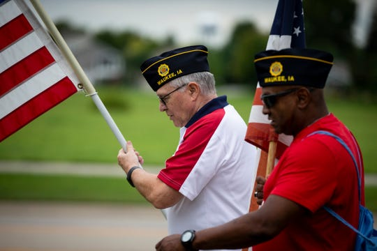 Veterans Jim Swearingen, left, and Reggie Bell, right, participate in the March to the Capitol on Wednesday, Sept. 11, 2019 in Waukee.