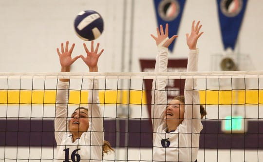Norwalk junior Lauren Magee and sophomore Abigail Brenizer throw up a block. Norwalk beat Pella Christian in three games in a Little Hawkeye Conference match in Norwalk on Sept. 10.
