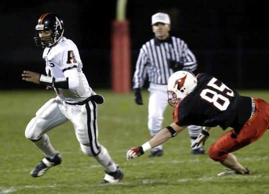 Oct. 31, 2003: Ames quarterback Austen Arnaud eludes Newton's Chase Madison.