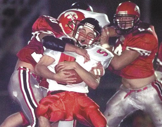 Sept. 22, 2000: City High's Brian Ferentz (right) closes in on a ball carrier during a game against Linn-Mar played at Bates Field in Iowa City.
