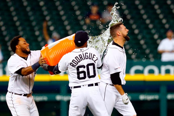 Detroit Tigers shortstop Jordy Mercer is dosed with water by second baseman Dawel Lugo and third baseman Ronny Rodriguez after his RBI single in the ninth inning against the New York Yankees at Comerica Park, Tuesday, Sept. 10, 2019.