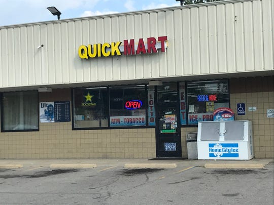 One lotto sign still appears in front of Quick Mart near Ypsilanti. But tickets are no longer available, after lottery officials determined the owner shortchanged a customer on a winning ticket.