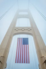 The American flag hung from Mackinac Bridge today.