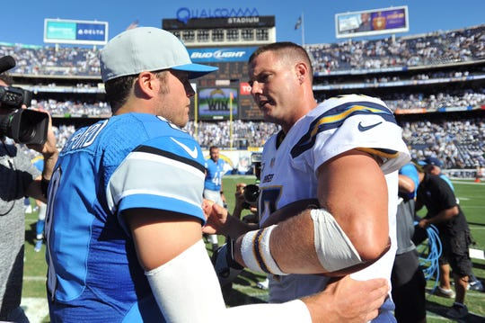 Detroit Lions quarterback Matthew Stafford and San Diego Chargers quarterback Philip Rivers meet after the Chargers' 33-28 win at Qualcomm Stadium in San Diego, Sept. 13, 2015.