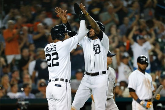Detroit Tigers' Harold Castro celebrates with Victor Reyes after scoring in the sixth inning against the New York Yankees in Detroit, Tuesday, Sept. 10, 2019.