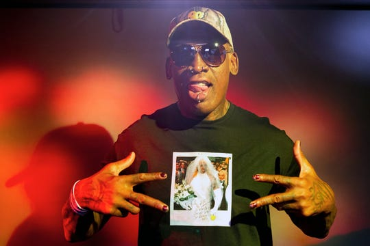 """Dennis Rodman on Sept. 9, 2019 wearing a T-shirt depicting himself in a wedding dress at a 1996 book promo event, in Los Angeles. The former NBA star was featured in a new ESPN """"30 For 30"""" documentary """"Dennis Rodman: For Better or Worse."""""""
