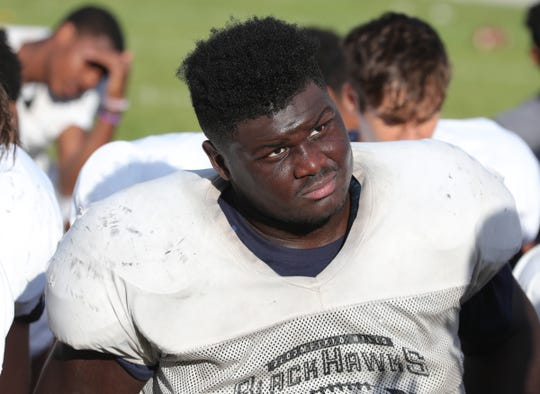 Bloomfield Hills defensive lineman Devin Holmes, who is deaf, during practice on Wednesday, Sept. 4, 2019, at Bloomfield Hills High School.