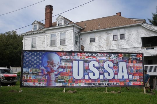 """Legendary street artist Ron English is responsible for this """"welcome wall"""" that overlooks a canal that runs along Parkview Drive in Detroit's Joseph Berry subdivision. The installation is part of the 2019 Murals in the Market festival."""