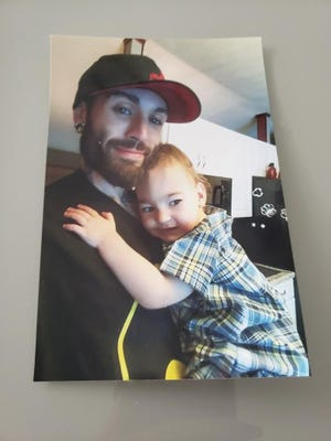 Jonathan Vanderhagen of Chesterfield Township with his son, Killian, in an undated family photo.