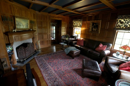 The handsome library is paneled and coffered with walnut. Its fireplace is carved from limestone and walnut. The house has five fireplaces, some of them very ornate.