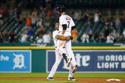 Detroit Tigers' Jordy Mercer celebrates with Jeimer Candelario (46) after his single to score Willi Castro in the ninth inning.