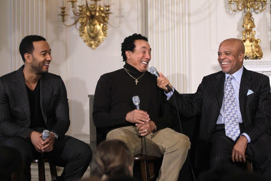 From left, singers John Legend, Smokey Robinson and Motown founder Berry Gordy Jr.  hold a discussion hosted by first lady Michelle Obama for students, highlighting Motown artists, Feb. 24, 2011, in the State Dining Room of the White House in Washington.