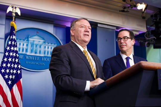 Secretary of State Mike Pompeo and Treasury Secretary Steve Mnuchin speak at the White House Tuesday, Sept. 10, 2019. After John Bolton's resignation as national security adviser, Pompeo is now without peer on Trump's national security team.