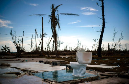 A toilet stands amid the rubble of what was once a home after it was destroyed by Hurricane Dorian one week ago in Pelican Point, Grand Bahama, Bahamas, Sunday, Sept. 8, 2019. The toll from the storm in the Bahamas stood at 44 Monday but officials have warned that the number of deaths is likely to rise as security forces and other teams search devastated areas of the northern Bahamas.