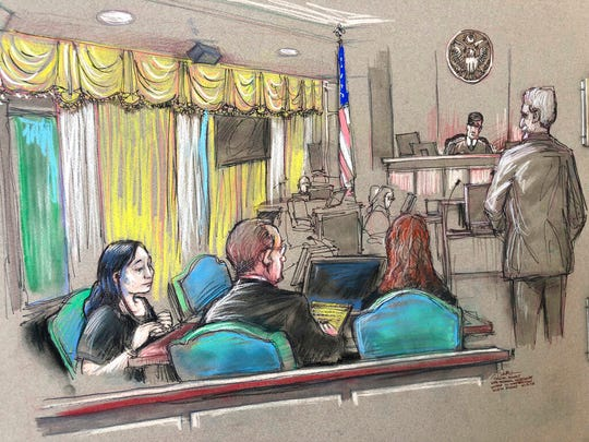 In this April 15, 2019, file court sketch, Yujing Zhang, left, a Chinese woman charged with lying to illegally enter President Donald Trump's Mar-a-Lago club, listens to a hearing before Magistrate Judge William Matthewman in West Palm Beach, Fla.