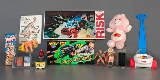In this Aug. 13, 2019 photo provided by the National Toy Hall of Fame are the 2019 finalists, from left to right, Jenga, Magic the Gathering, My Little Pony, Coloring Book, Matchbox Cars, Top, Nerf Blaster, Risk, Masters of the Universe, Care Bears, Smartphone, and Fisher-Price Corn Popper.