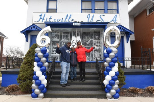 Visitors Steve Thomas, left, of Oak Park,  his son DeMarco, 10, and wife Lisette smile and wave outside the Motown Museum as it promotes its 60th anniversary on January 12, 2019.  The museum has planned a series of events Sept. 21-24 to celebrate the 60th anniversary of Motown Records.