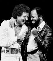 Smokey Robinson, left, is joined by Berry Gordy Jr. at the Greek Theater in Los Angeles on June 15, 1981.