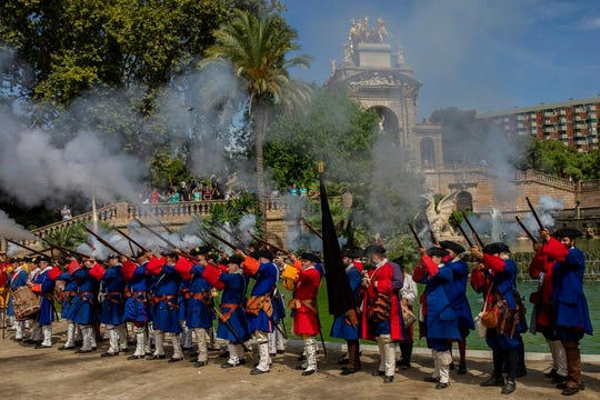 A group reenacts Catalan army units from the War of the Spanish Succession during a performance to celebrate the Catalan National Day in Barcelona, Spain, Wednesday, Sept. 11, 2019.