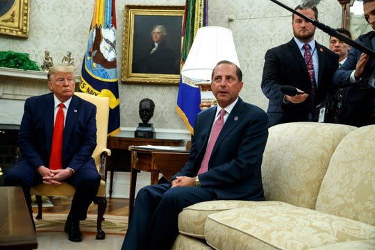 President Donald Trump listens as Secretary of Health and Human Services Alex Azar talks about a plan to ban most flavored e-cigarettes Wednesday, Sept. 11, 2019, in Washington.