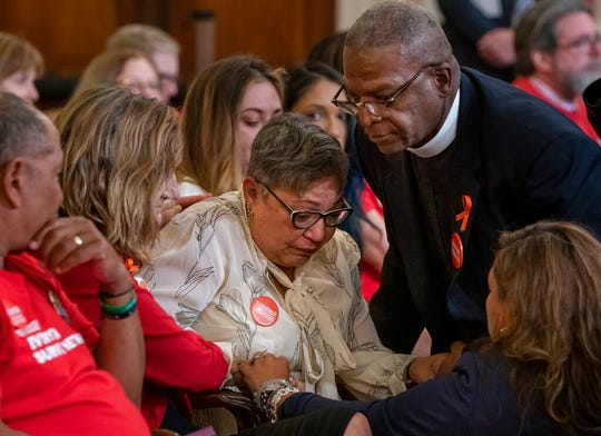 Pastor Jackie Jackson, right, an anti-violence advocate from Cincinnati, is joined by gun violence survivor Mia Livas Porter, lower right, of Los Angeles, as they comfort Rev. Sharon Risher, center, whose mother was killed in the shooting at the Emanuel AME Church shooting in Charleston, S.C., during a House Democratic forum urging the Senate to vote on a bill that would expand background checks for gun purchases, on Capitol Hill in Washington, Tuesday, Sept. 10, 2019.