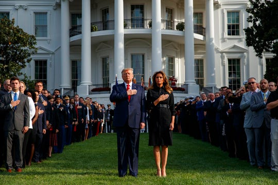 President Donald Trump and first lady Melania Trump participate in a moment of silence honoring the victims of the Sept. 11 terrorist attacks, on the South Lawn of the White House, Wednesday, Sept. 11, 2019.
