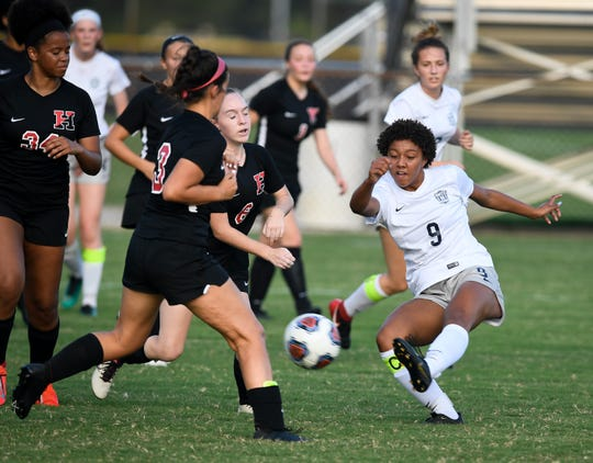 Reitz's Naomi Splittorff (9) passes to a teammate as the Reitz Panthers play the Harrison Warriors at the EVSC Soccer Complex Tuesday evening, September 10, 2019.