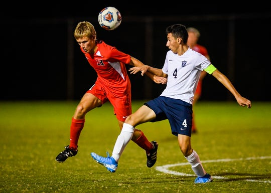 Harrison's Conner Wilson (11) heads the ball under pressure from Reitz's Leivin Martinez (4) as the Reitz Panthers play the Harrison Warriors at the EVSC Soccer Complex Tuesday evening, September 10, 2019.