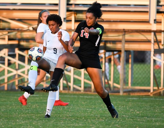 Reitz's Naomi Splittorff (9) and Harrison's Tela Williams (14) battle for the ball as the Reitz Panthers play the Harrison Warriors at the EVSC Soccer Complex Tuesday evening, September 10, 2019.