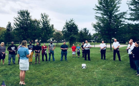 Event Organizer Bre Zoch gives remarks to community members who gathered for the 9/11 Never Forget ceremony on Sept. 11, 2019 at Hamilton Park.